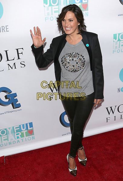Mariska Hargitay<br /> The JoyROCKS: An Evening to benfit Mariska Hagitay's Joyful Heart Foundation and to celebrate the NO MORE PSA Launch in Los Angeles, California, USA.<br /> September 26th, 2013 <br /> full length black trousers blazer grey hand arm palm waving gray top leather trousers  <br /> CAP/MPC<br /> &copy;MediaPunch/Capital Pictures