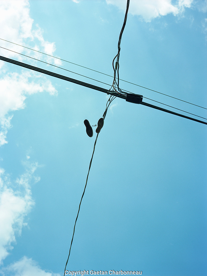 Pair of shoes hanging from power lines