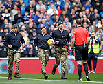 14.09.2019 Rangers v Livingston: the matchball is rushed to the referee after abseiling from the roof of the stadium