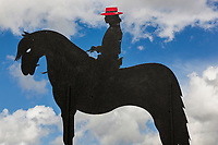 Spain. Balearic Islands. Minorca (Menorca). Son Martorellet. Son Martorellet is a place where the Pure Breed Minorcan horses are breed and trained. The place has daily summer shows for tourists on Menorcan dressage. On the parking's wall, an iron statue of a rider with a red hat and a horse. The Menorquín is a breed of horse indigenous to the island and is closely associated with the doma menorquina style of riding. The most valued quality of Menorquín horse is its suitability for the traditional festivals of Menorca. Horses and riders are usually at the centre of local fiesta celebrations. Son Martorellet is located in the centre of the island, which is part of the autonomous community of the Balearic. In Spain, an autonomous community is a first-level political and administrative division, created in accordance with the Spanish constitution of 1978, with the aim of guaranteeing limited autonomy of the nationalities and regions that make up Spain. 11.09.2019 © 2019 Didier Ruef