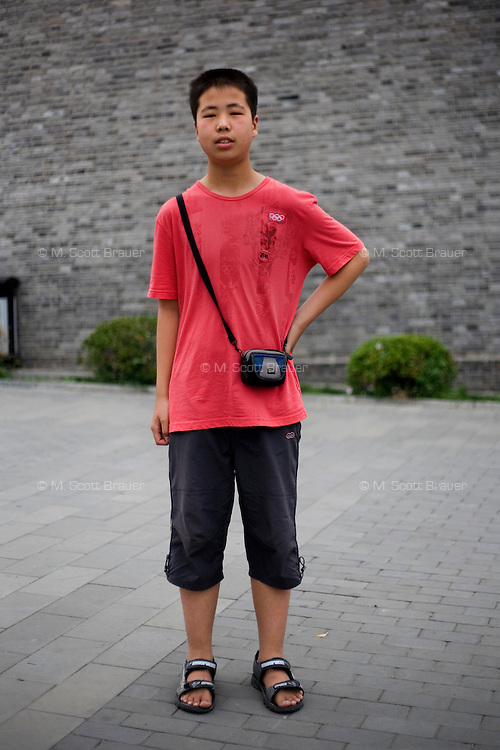 Guqiangang, a student, age 15, poses for a portrait in Badaling. Response to 'What does China mean to you?': 'It is my country. My home land, the place where I was brought up.'  Response to 'What is your role in China's future?': 'To become a pillar in the creation [of China's future].'