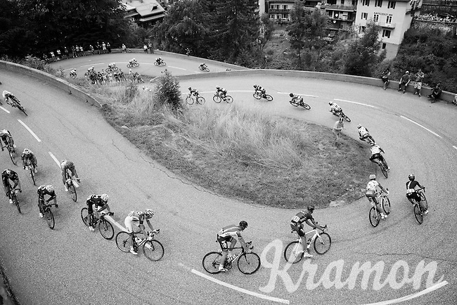 peloton entering the village of Flumet via some short switchbacks<br /> <br /> Stage 20: Megève › Morzine (146.5km)<br /> 103rd Tour de France 2016