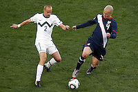 Miso Brecko (L) of Slovenia and Michael Bradley (R) of USA