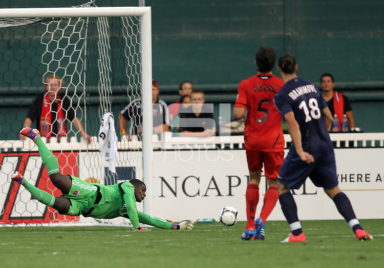 WASHINGTON, DC - July 28, 2012:  Bill Hamid (28) of DC United saves from Zlatan Ibrahimovic (18) of PSG (Paris Saint-Germain) in an international friendly match at RFK Stadium in Washington DC on July 28. The game ended in a 1-1 tie.