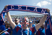 MOSCOW, RUSSIA - June 16, 2018: An Iceland fan holds up an Iceland scarf while singing a song at a pre-game rally at Zaryadiye park before their game against Argentina at the 2018 FIFA World Cup.