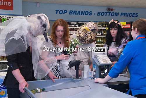 Made In Spring. Roath Cardiff Wales. The May Queen and her attendants purchasing some refreshments in Home Bargains. May 2014