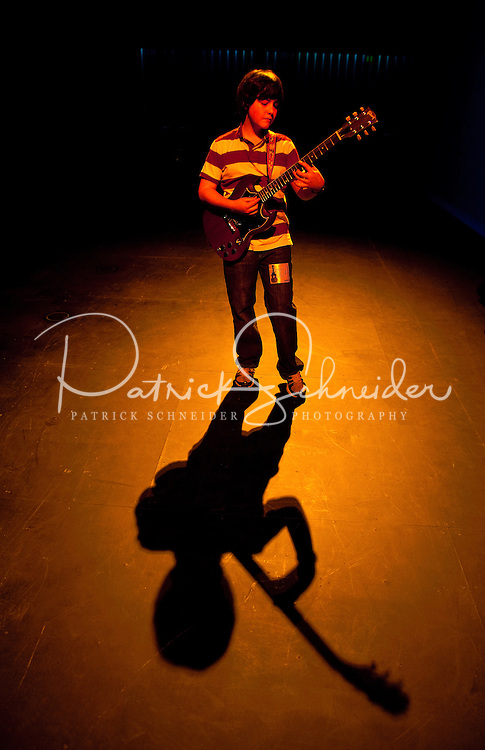 A young musician plays guitar onstage during the 20th year of the Tosco Music Party, held at the Overcash Academic and Performing Arts Center Dale F. Halton Theater Central Piedmont Community College. The annual event, named after John Tosco, owner of the Tosco Music Studio, is designed to showcase professional and amateur musicians.