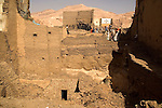 "Houses being demolished. Several houses in this block belong to the famous El-Rassoul family. At the bottom of the excavation, underneath where houses once existed, an entrance to a tomb is visible. The site inspector called it ""an important model of a XXVI Dynasty tomb with some intact inscriptions"" and a sealed burial chamber..Qurna, Luxor, Egypt..Photo: Eduardo Martino"