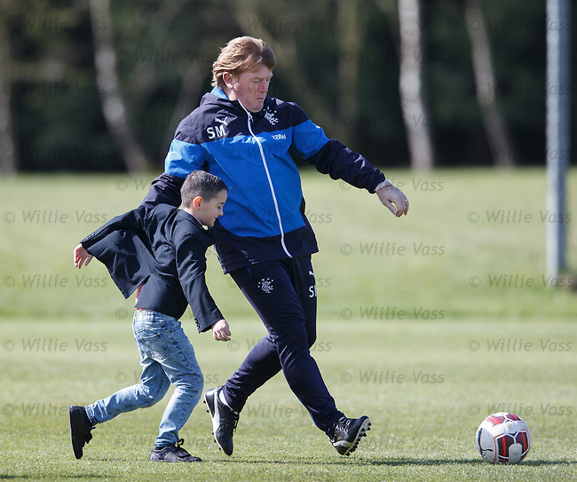 Stuart McCall with some young supporters at training