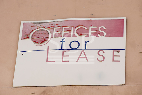 """California, USA. """"Offices For Lease"""" sign with peeling red paint."""