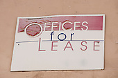 "California, USA. ""Offices For Lease"" sign with peeling red paint."