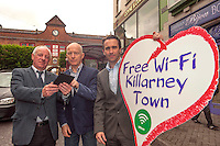 Tourists and locals in Killarney Town in County Kerry  are now surfing their phonee, laptops and mobile devices in a 'free Wi-Fi zone' thanks to the installation of free Wi-Fi by bitbuzz, Ireland's leading provider of Wi-Fi services. Pictured at the Market Cross in Killarney on Monday after the switching on of the service are  from left, Michael O'leary, Town Clerk, Johnny McGuire, President, Killarney Chamber of Tourism &amp; Commerce and Shane Deasy, bitbuzz. <br /> Picture by Don MacMonagle<br /> <br /> FURTHER INFORMATION: Johnny McGuire 0858722546