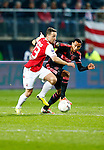 Nederland, Alkmaar, 27 maart 2014<br /> KNVB Beker<br /> Seizoen 2013-2014<br /> Halve finale<br /> AZ-Ajax<br /> Roy Beerens (l.) van AZ en Ricardo van Rhijn (r.) van Ajax strijden om de bal.