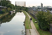 Cyclist on the tow path by the Grand Union canal in West London.