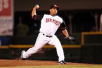 Rochester Red Wings pitcher Lester Oliveros #15 delivers a pitch during a game against the Lehigh Valley IronPigs at Frontier Field on August 18, 2011 in Rochester, New York.  Lehigh Valley defeated Rochester 11-1.  (Mike Janes/Four Seam Images)