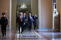 White House Director of Legislative Affairs Eric Ueland, United States Secretary of the Treasury Steven T. Mnuchin, and United States Representative Mark Meadows (Republican of North Carolina) leave the office of United States Senate Majority Leader Mitch McConnell (Republican of Kentucky) at the United States Capitol in Washington D.C., U.S. on Tuesday, March 24, 2020.  The Senate is working to finalize a deal on the Coronavirus Stimulus Package, after it was blocked by Senate Democrats two days in a row.  Credit: Stefani Reynolds / CNP/AdMedia