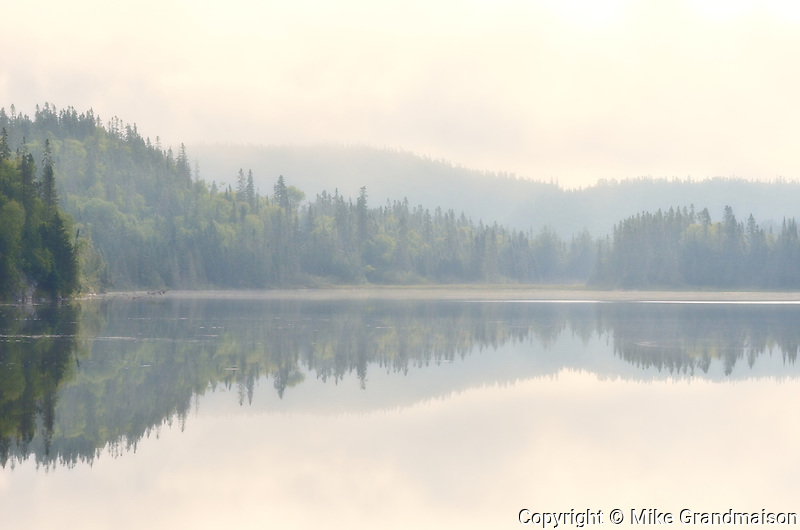 Morning fog on northern lake<br /> Near Schreiber<br /> Ontario<br /> Canada