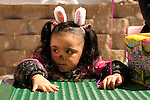 Kendra Rivas, 4, of Carson City, watches the action at the 7th Annual Easter Fiesta at Western Nevada College Saturday, March 26, 2016. The event, hosted by the Association of Latin American Students, had 3 separate egg hunts, face painting, limbo, musical chairs, ring toss, sack races, bowling,  food, music and a piñata.  <br />