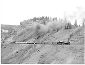 D&amp;RGW freight headed by #490 with boxes, coal, lumber and a K-36 pushing coming off Windy Point, almost at Cumbres.<br /> D&amp;RGW  Windy Point, CO  Taken by Richardson, Robert W.