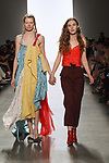 Graduating design student Lyudmila Sullivan, walks runway with model at the close of 2017 Pratt fashion show on May 4, 2017 at Spring Studios in New York City.