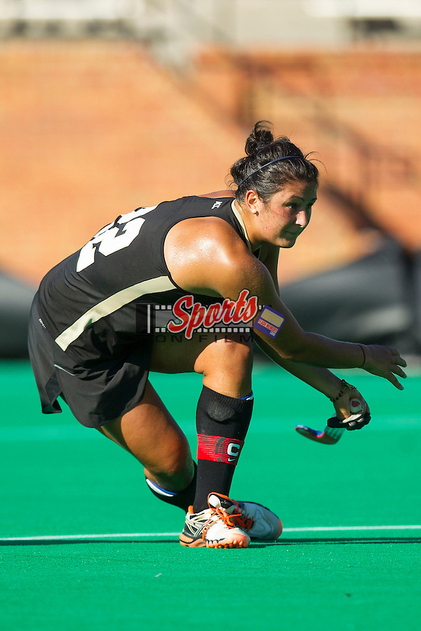 Anna Kozniuk (22) of the Wake Forest Demon Deacons follows through on a shot on goal during first half action against the Liberty Flames at Kentner Stadium on September 13, 2013 in Winston-Salem, North Carolina.  The Demon Deacons defeated the Flames 3-2.  (Brian Westerholt/Sports On Film)