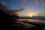 Reflections of pink clouds in sea water pool. Playa del Piloto, El Hierro, Canary Islands, Spain