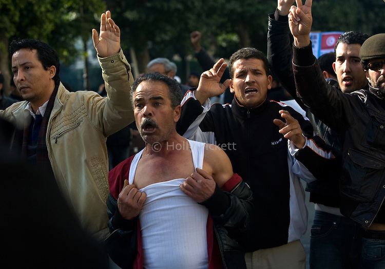 Protesters reacted to police during a demonstration against the interim government, in downtown Tunis, Tunisia, Jan. 17, 2011. The Tunisian police and army struggled to maintain order in the capital, as thousands of protesters once again filled the streets.