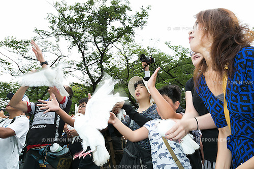 People release white pigeons on the 71st anniversary of Japan's surrender in World War II at Yasukuni Shrine on August 15, 2016, Tokyo, Japan. Some 70 lawmakers visited the Shrine to pay their respects, but the Prime Minister Shinzo Abe did not visit the controversial symbol and instead sent a ritual offering to a shrine. Yasukuni enshrines the war dead including war criminals and as such visits by Japanese  politicians tend to provoke anger from neighbors China and Korea that suffered from Japan's militarist past. (Photo by Rodrigo Reyes Marin/AFLO)