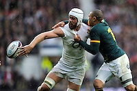 Dave Attwood of England offloads as he is tackled by Bryan Habana of South Africa during the QBE International match between England and South Africa at Twickenham Stadium on Saturday 15th November 2014 (Photo by Rob Munro)