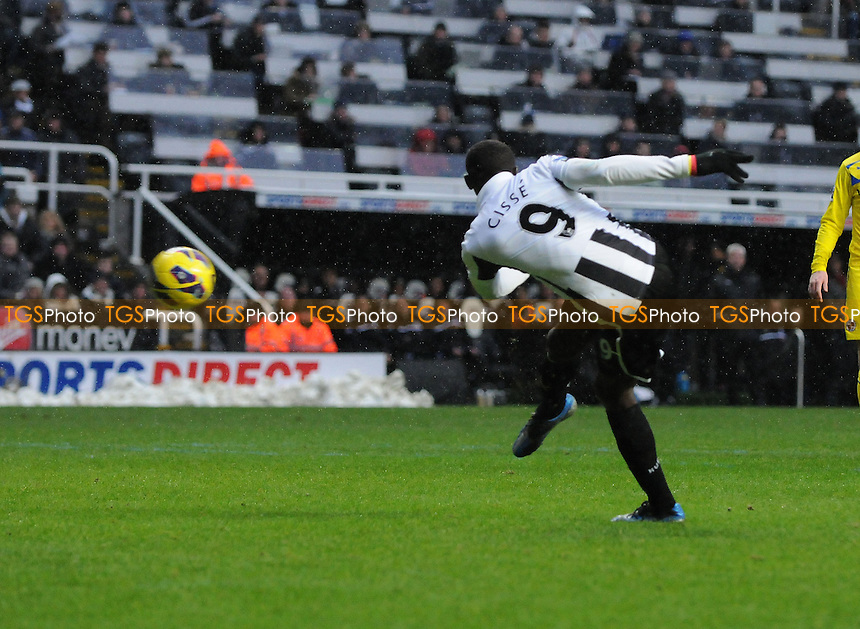 Newcastle United striker Papiss Cissé has a first half shot saved by Reading goalkeeper Adam Federici - Newcastle United vs Reading - Barclays Premier League Football at St James Park, Newcastle upon Tyne - 19/01/13 - MANDATORY CREDIT: Steven White/TGSPHOTO - Self billing applies where appropriate - 0845 094 6026 - contact@tgsphoto.co.uk - NO UNPAID USE.