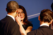 Pittsburgh, PA - September 24, 2009 -- United States President Barack Obama (L) talks with French President Nicolas Sarkozy's wife Carla Bruni Sarkozy (C) while welcoming her to the opening dinner for G-20 leaders at the Phipps Conservatory on Thursday, September 24, 2009 in Pittsburgh, Pennsylvania. Heads of state from the world's leading economic powers arrived today for the two-day G-20 summit held at the David L. Lawrence Convention Center aimed at promoting economic growth.  .Credit: Win McNamee / Pool via CNP