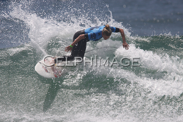 LEILANI GRYDE.in competition on day three of the 2010 US Open of Surfing. Huntington Beach, CA, USA. August 2, 2010.