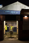 Southend United 1 Burton Albion 1, 22/02/2016. Roots Hall, League One. Stewards stand on guard at the deserted away end turnstiles at Roots Hall stadium, before Southend United took on Burton Albion in a League 1 fixture. Founded in 1906, Southend United moved into their current ground in 1955, the construction of which was funded by the club's supporters. Southend won this match by 3-1, watched by a crowd of 6503. Photo by Colin McPherson.