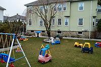 A variety of children's toys are seen in the yard of a closed home-based daycare in Belmont, Massachusetts, on Fri., March 20, 2020. Earlier in the week, the Town closed all parks, fields, courts, and playgrounds, as part of the lockdown response to the ongoing coronavirus COVID-19 pandemic. The governor of Massachusetts ordered most daycares in the state to close down until April 6.