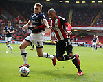 Leon Clarke of Sheffield Utd and Shaun Hutchinson of Millwall during the championship match at the Bramall Lane Stadium, Sheffield. Picture date 14th April 2018. Picture credit should read: Simon Bellis/Sportimage