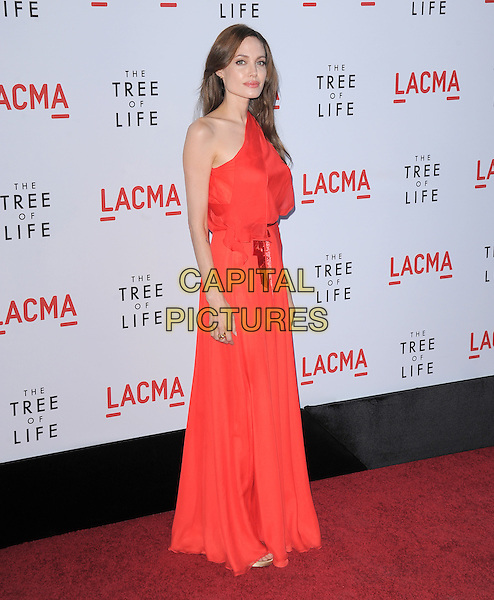"ANGELINA JOLIE.L.A. Premiere of ""The Tree of Life"" held at The Bing Theatre at LACMA in Los Angeles, California, USA. .May 24th, 2011    .full length maxi dress side one shoulder red orange.CAP/RKE/DVS.©DVS/RockinExposures/Capital Pictures."