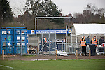 Wealdstone 0 Newport County 0, 17/03/2012. St Georges Stadium, FA Trophy Semi Final. Stewards on duty waiting for the arrival of fans outside St Georges Stadium, home ground of Wealdstone FC, before the club played host to Newport County in the semi-final second leg of the F.A. Trophy. The game ended in a goalless draw, watched by a capacity crowd of 2,092 which meant the visitors from Wales progressed by three goals to one to the competition's final at Wembley, where they would meet York City. The F.A. Trophy was the premier cup competition for non-League clubs in England and Wales affiliated to the Football Association. Photo by Colin McPherson.