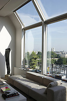 High above the roofs of Paris the curtainless picture windows provide stunning views over Paris