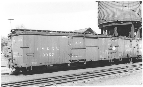 Box car #3057 at Salida with outfit car #04910.<br /> D&amp;RGW  Salida, CO  Taken by Boyd, J. T. - 6/9/1935