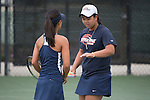 April 25, 2014; San Diego, CA, USA; Pepperdine Waves player Lorraine Guillermo (left) and Apichaya Runglerdkriangkrai (right) during the WCC Tennis Championships at Barnes Tennis Center.
