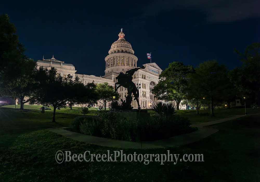 The cowboy way staue with horse and rider with the Texas Capital all lit up at night panorama was kind of different view of the state capital.