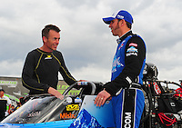 Mar. 9, 2012; Gainesville, FL, USA; NHRA top fuel dragster driver Clay Millican (left) and T.J. Zizzo during qualifying for the Gatornationals at Auto Plus Raceway at Gainesville. Mandatory Credit: Mark J. Rebilas-