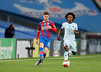 7th July 2020; Selhurst Park, London, England; English Premier League Football, Crystal Palace versus Chelsea; James McCarthy of Crystal Palace passing the ball away from Willian of Chelsea