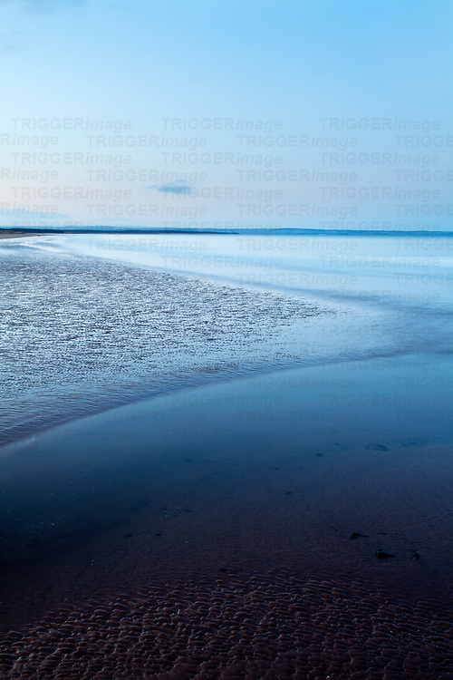 Blue Water and Sand Ripples at West Sands at Dusk St Andrews Fife Scotland