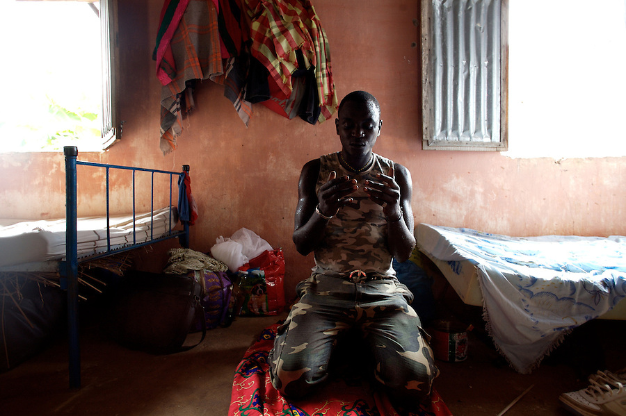 """Americo, 27 years old, former Quiza ( a mixture of cocaine and other drugs, smoked like crack ) addict, prays during Ramadan at  the """"Desafio Jovem"""" a rehabilitation community in the outskirts of Bissau, Guinea Bissau on Sunday Sept 16 2007.///..Guinea Bissau is infamous for its cocaine trafficking. in 2005 Colombian cartels begun to arrive in the country transforming it into a Narco State. Up to 5 tons of pure cocaine are estimated to be arriving in the country every week. Guinea Bissau is the 5th poorest country in the world, making it the ideal transit base for the cocaine that will finish on the european markets. Corruption and involvement in the trafficking are present at every level of its institutions..Guinea Bissau is only one of the countries in West Africa involved in cocaine trafficking. Tons of Cocaine have been seized in Nigeria, Senegal, Ghana and  Sierra Leone."""