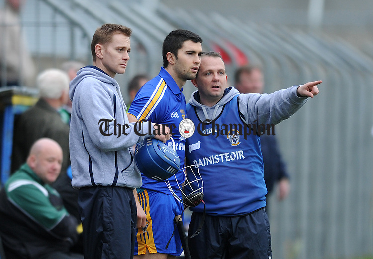 Davy Fitzgerald gives instruction to Caimin Morey as Joe O' Connor looks on. Photograph by Declan Monaghan
