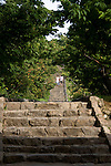 Visitors walk down the steps that lead from the main ward to the Heirojo Gate at the Nakajin Castle ruins in Nakajin VILLAGE, Okinawa Prefecture, Japan, on May 20, 2012. Photographer: Robert Gilhooly