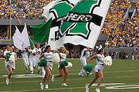 The Marshall Cheerleaders. The WVU Mountaineers beat the Marshall Thundering Herd 34-13 in a game called just after the fourth quarter started because of severe thunderstorms in the area. The game was played at Milan Puskar Stadium in Morgantown, West Virginia on September 4, 2011.