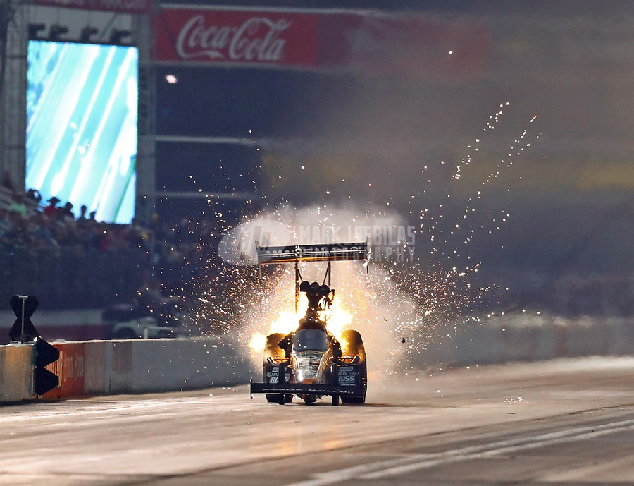 Nov 10, 2018; Pomona, CA, USA; Sparks fly as NHRA top fuel driver Terry McMillen suffers an engine explosion in his dragster during qualifying for the Auto Club Finals at Auto Club Raceway. Mandatory Credit: Mark J. Rebilas-USA TODAY Sports