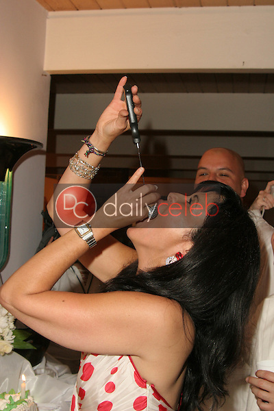 Maria Conchita Alonso has a taste of her birthday cake<br />